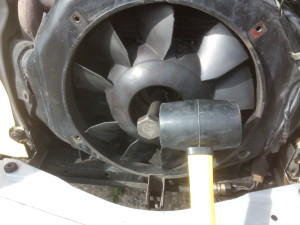 Specialist tools in use removing a 2CV fan