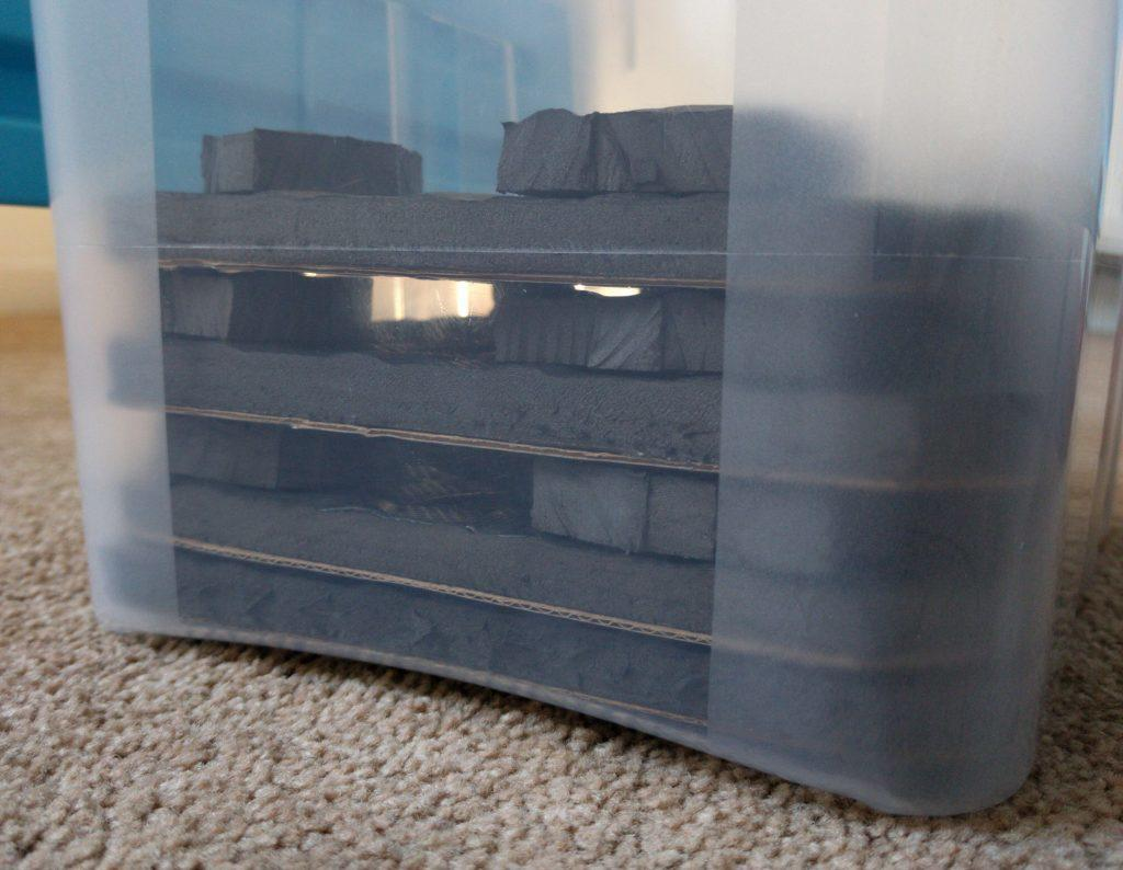 Storage trays stacked in box