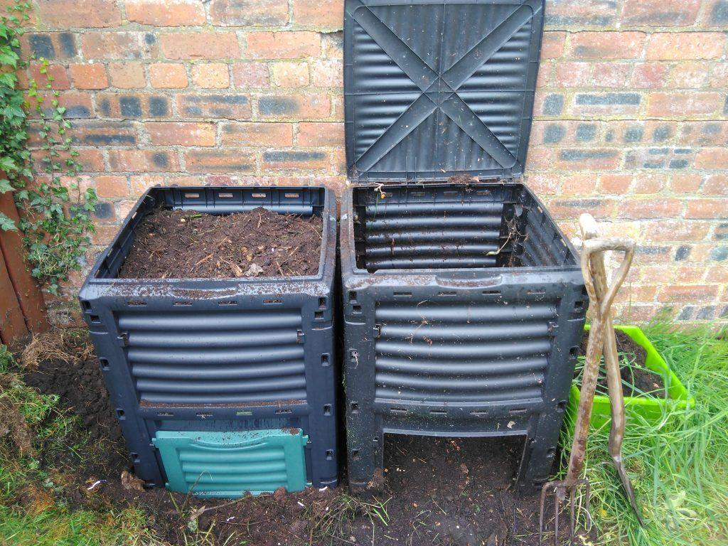 Two compost bins - left full, right empty