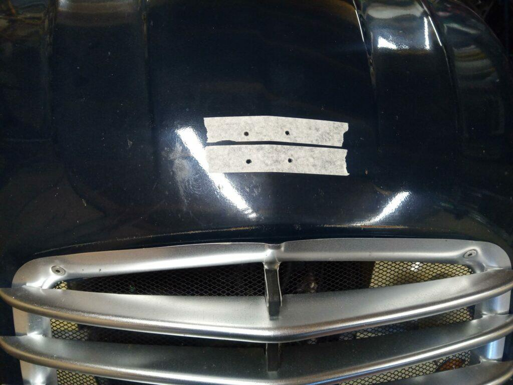 drilled holes for chevrons on a 2CV bonnet